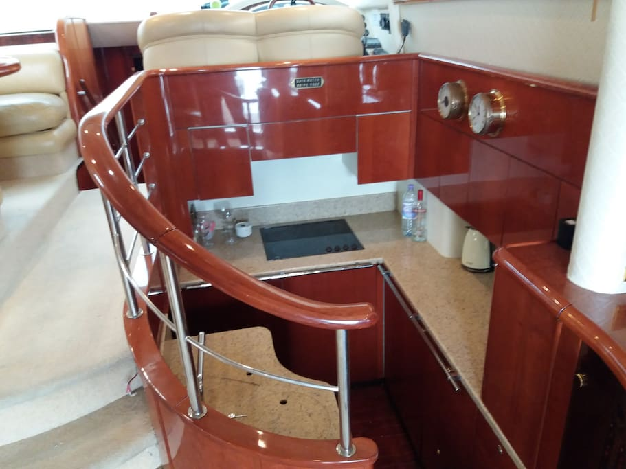 Galley, with utility room below, 6 climate control zones throughout. 4 ring halogen hob, microwave, fridge and freezer.