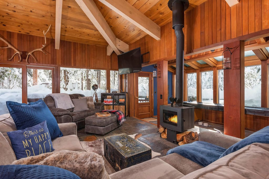 As you step inside, you'll enter an open-concept living space with a classic mountain lodge feel