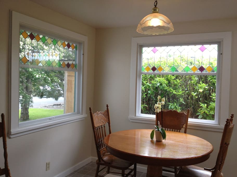 Kitchen eating area with original stained glass windows