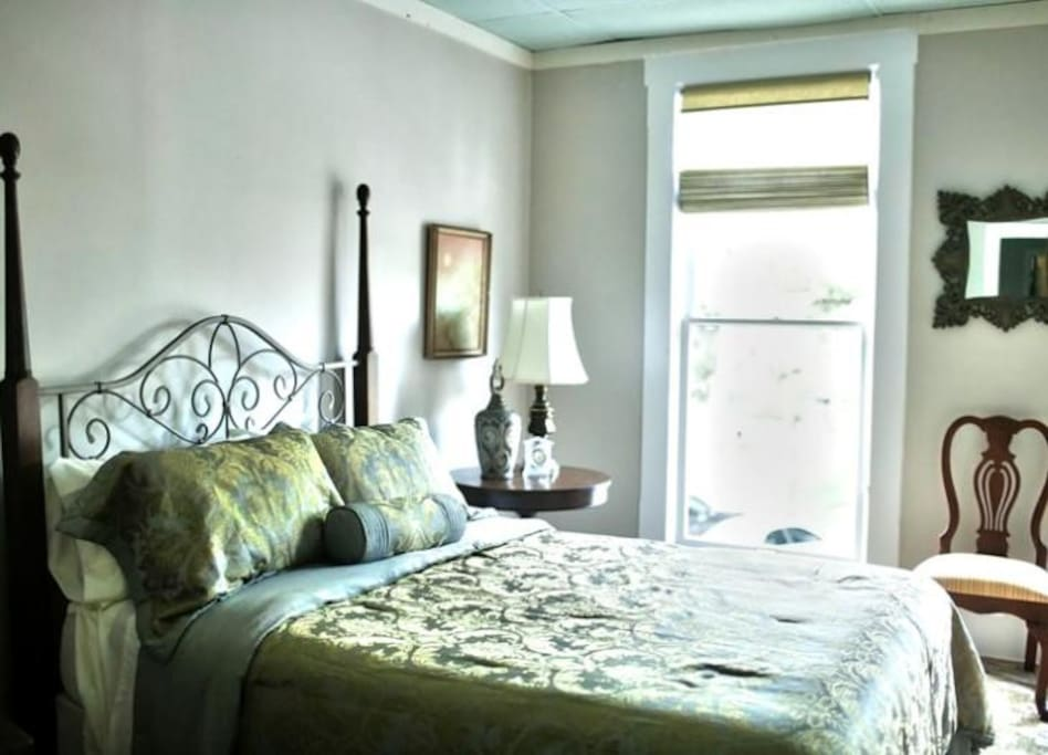 Separate bedroom with Queen size bed and view of the square.