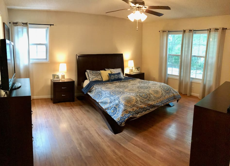 "Master bedroom with plush queen size bed, private bathroom and 32"" TV with Chromecast"