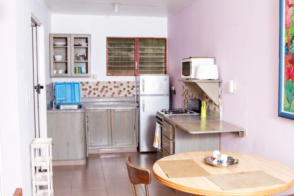Newly renovated kitchen with work surface flap that can be lifted against wall, Slightly lowered granite work-surfaces
