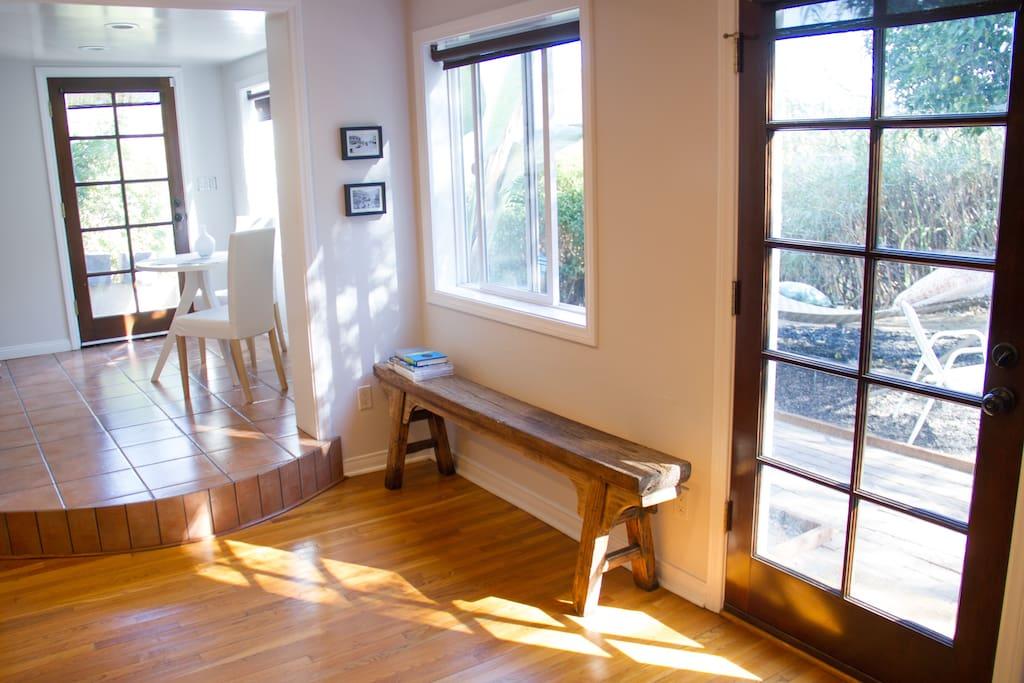 Bright morning sunlight floods living room.