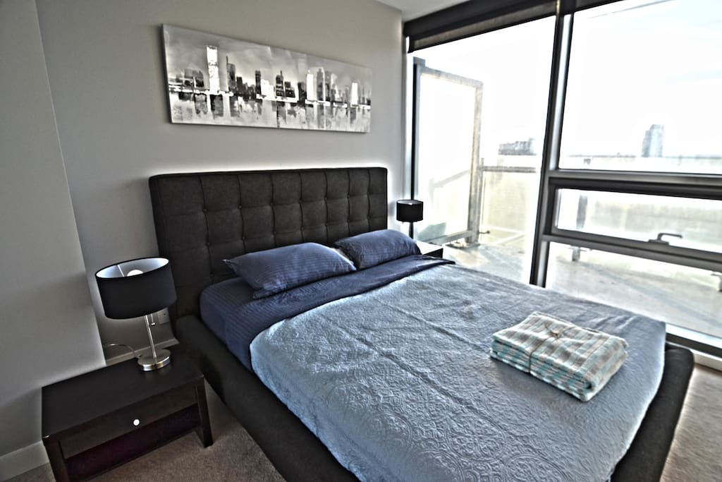 Master Bedroom with Queen Size Bed, Full Wardrobe Closet and Immaculate City Views!