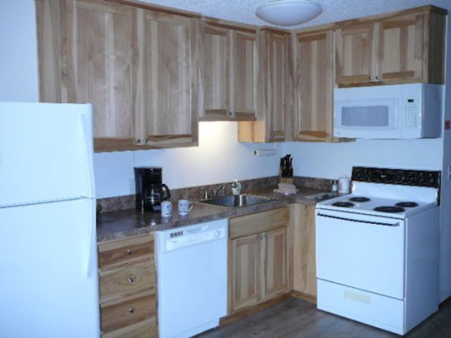 The kitchen is fully equipped with all utensils and appliances. We even provide the coffee!
