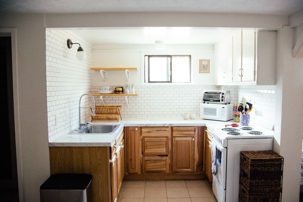 Freshly remodeled kitchen space with all the necessary appliances and utensils.