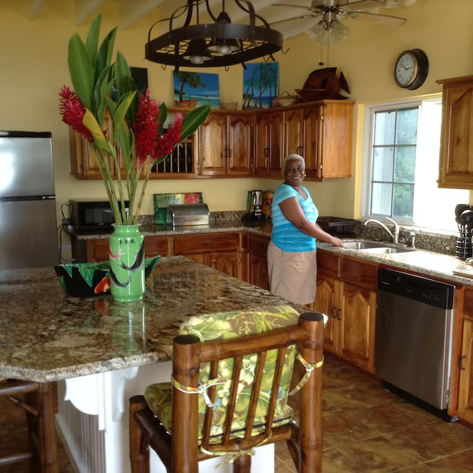 Granite counter tops and island are featured in the kitchen. Sharon, your cook, is fabulous!