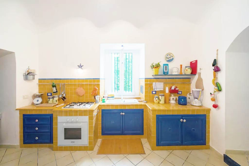 Full kitchen with a refrigerator and kitchenware
