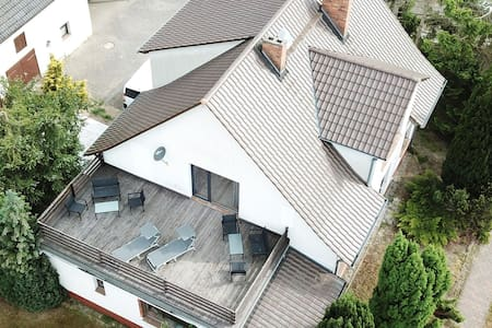 Large holiday home with roof terrace and big garden with lounge area and grill