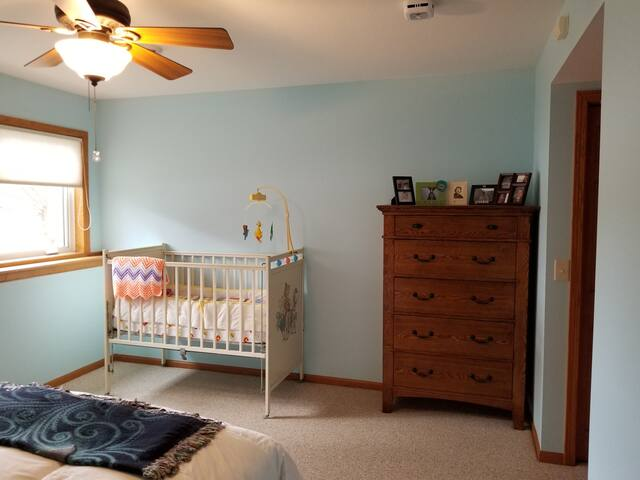 Crib in guest bedroom