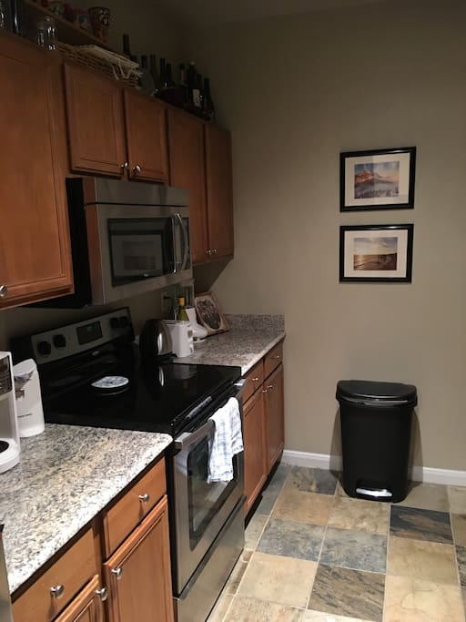 Stainless steal appliances and granite countertops.