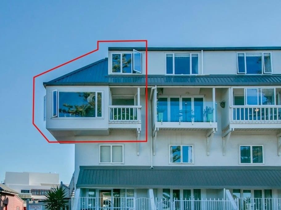 The top two level end unit is located in a prime location.