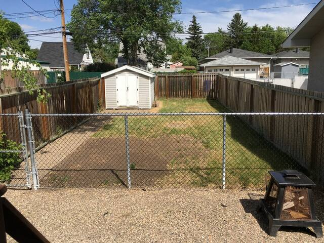 Fenced Back Yard for pets, and small firepit.