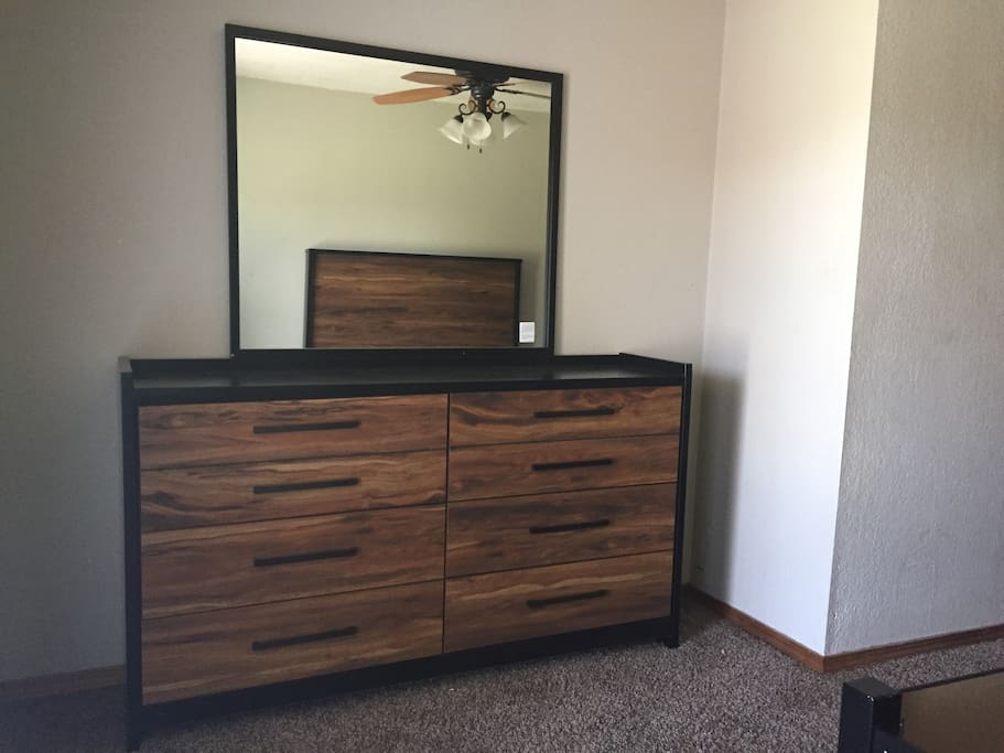 Second bedroom with queen bed and dresser.