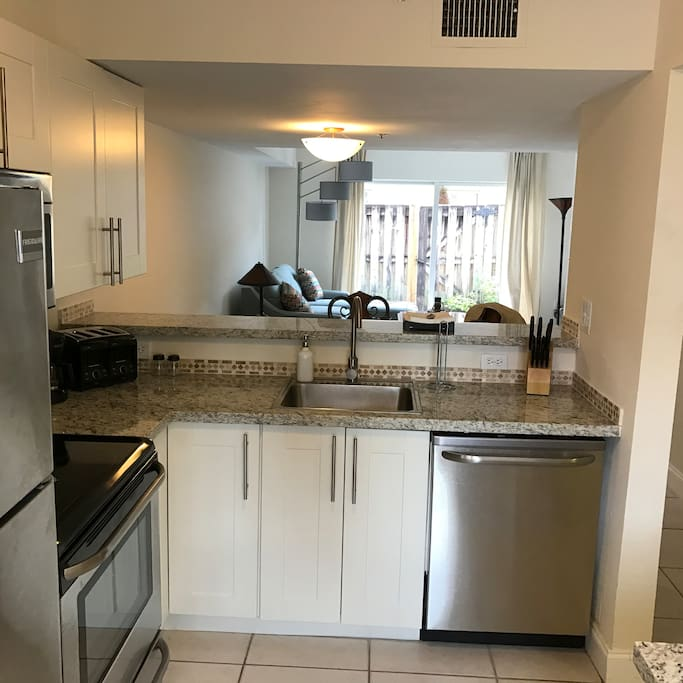 Fully functional kitchen with stainless steel appliances. Dishwasher. Washer and dryer inside the unit.
