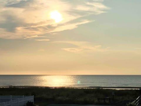Les orteils sableux et les couchers de soleil