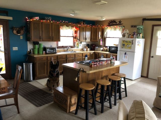 Kitchen - stove, oven, microwave, k-cup coffee maker, toaster oven, blender, mixer, toaster, plenty of pots and pans.