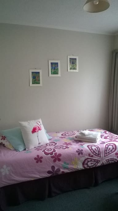 Pink Flamingo Style - Guest bedroom with the Single bed that is now in it, with a double wardrobe and NZ made armchair - as of May 2018