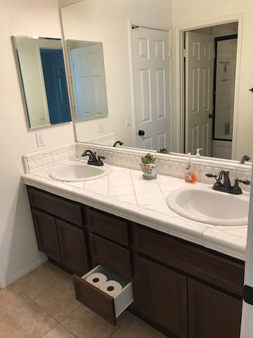 Clean double washstand and bathroom.