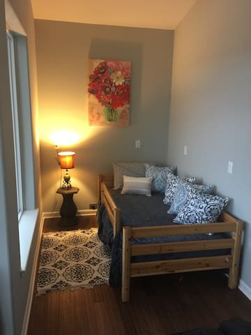 Twin bed nook off the living area for kids area or additional adult sleeping