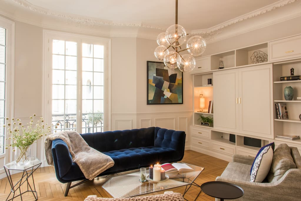 Living room with incredible views of Paris. Hiding behind cabinetry is a 4K 55-inch TV with cable and Netflix. The Internet is gigabit fiber!
