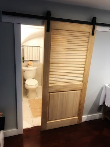 Entry to the bathroom, there is a stand up shower but not tub