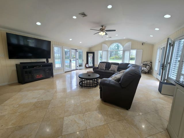 Spacious Sun Room with pull out sectional and extra areas for air beds.