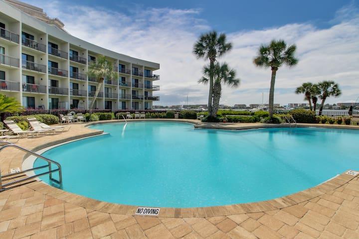 Garden-level coastal condo w/ patio, shared pool & sound views!