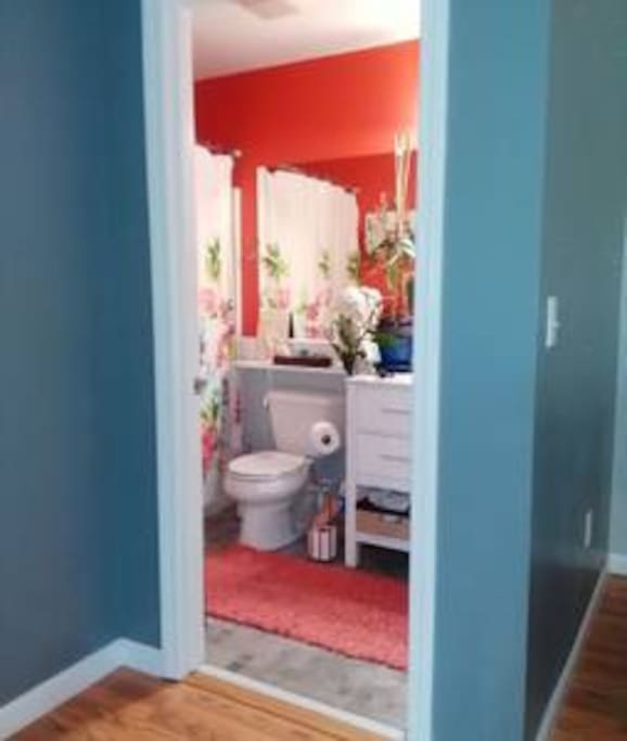 The bathroom is conveniently located across from the guest room. There are plenty of white towels and    a large choice of toiletries.