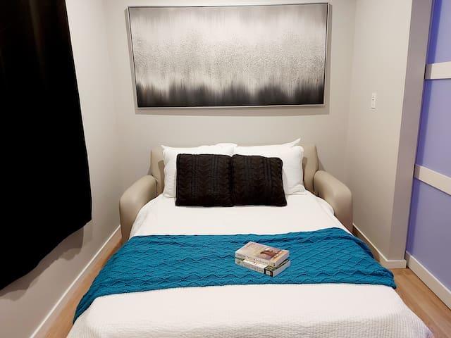 Hideaway full size bed in convertible bedroom