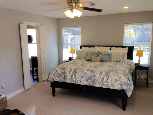 Large Master Bedroom with private bathroom oasis and private access to the backyard.