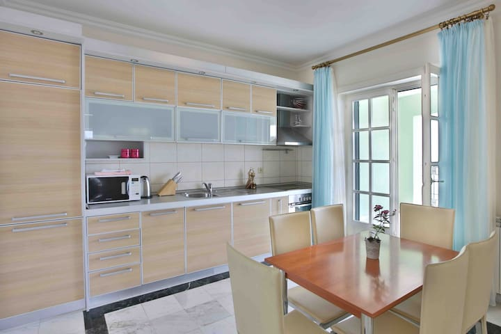 Kitchen with all necessary elements and dining area.