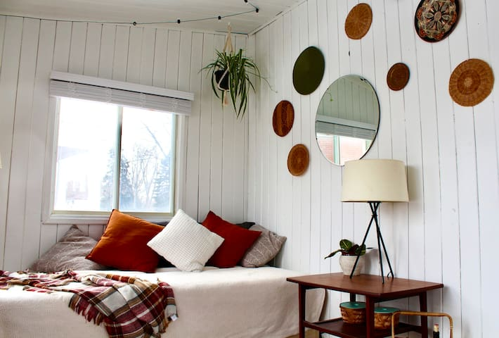 """We don't believe in """"Too many pillows"""". This day bed also converts  to a double bed! (Sunroom)"""