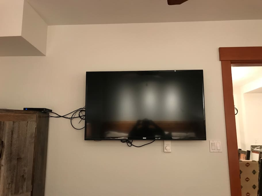 Flat screen TV near the foot of the bed.