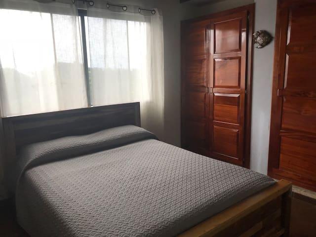 Bedroom with custom queen.