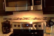New Stainless Steel glasstop stove and microwave.