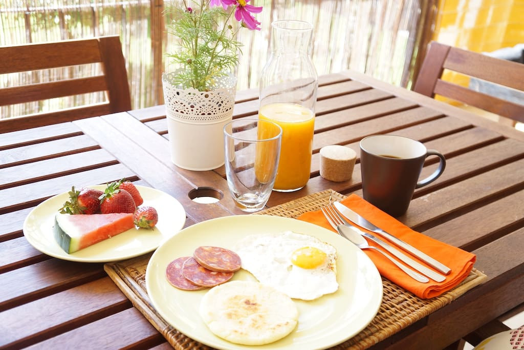 Enjoy breakfast at the terrace. Vegan and gluten free breakfast also available.
