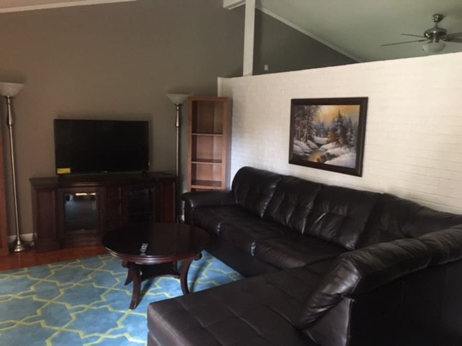 Living room that comfortably accommodates eight.  Smart TV with internet access.