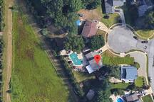 This is the satellite view of how private the pool is and how large compared to a 4 bedroom 2 car garage home. Pool is a good size. Also, private culture-de sac so quite safe for kids.