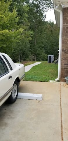 Guest Parking Spot with Pebble Walkway to Private Rear Entrance