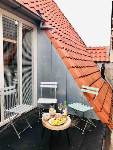 Luxe topappartement in sfeervol pand met dakterras