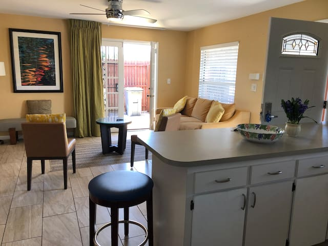 Family room area with access to outdoor deck. Sofa bed opens, and can sleep 2 persons.