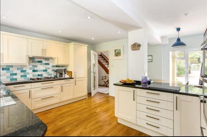 Large central kitchen is stand out feature. Granite worktops, Neff appliances, dishwasher, 5 hob Neff gas cooker, double oven, microwave, computerised toaster, toastie machine, fire blanket and extinguisher, nespresso, coffee and tea.