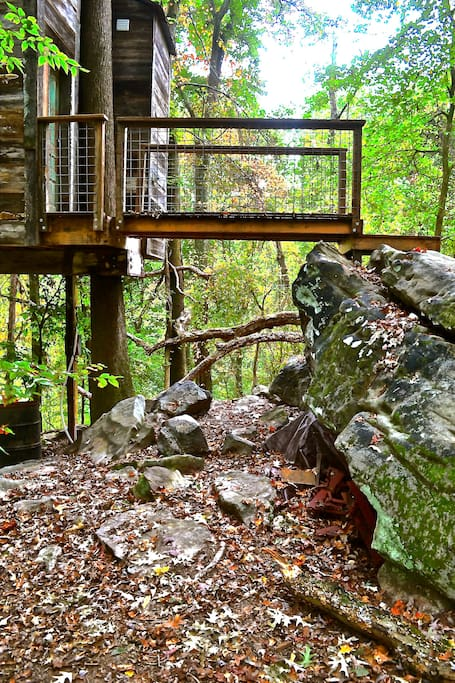 Bridge from beautiful boulders to a magical wonderland of reclaimed materials and childlike imagination.