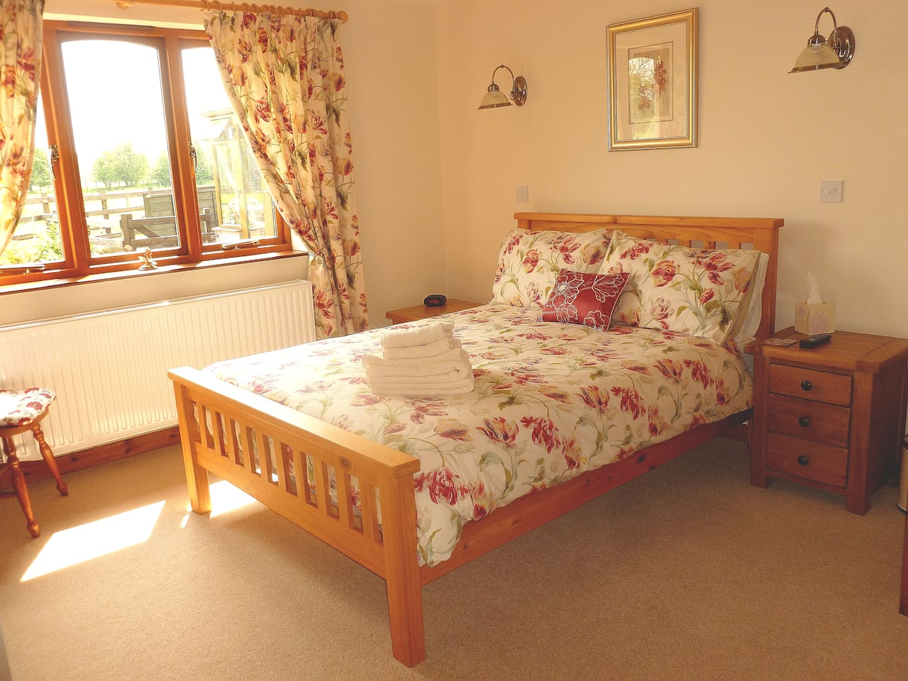 En-suite room over looking fields and garden.  Large bright room double bed and a single bed just out of view.