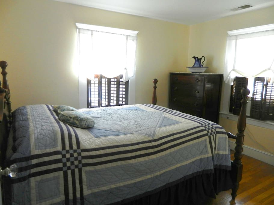 Lovely blue and white bedroom with full size poster bed.