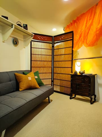 Our new update - welcome to The Zen Den. A quiet place in the Nest, for all your meditation and resting needs. Large walk in closet that has been converted into a cozy bedroom with twin futon.
