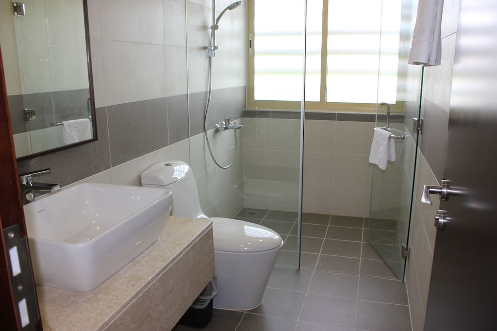 All modern fixtures with plenty of light. All bathroom amenities provided - hair dryer, cotton buds, shampoo, bodywash, etc.