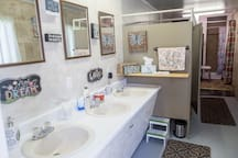 You're welcome to use our cute communal bathrooms in addition to the private bathroom in your camper