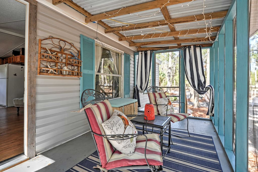 The home offers a spacious screened porch, perfect for sipping your morning coffee.